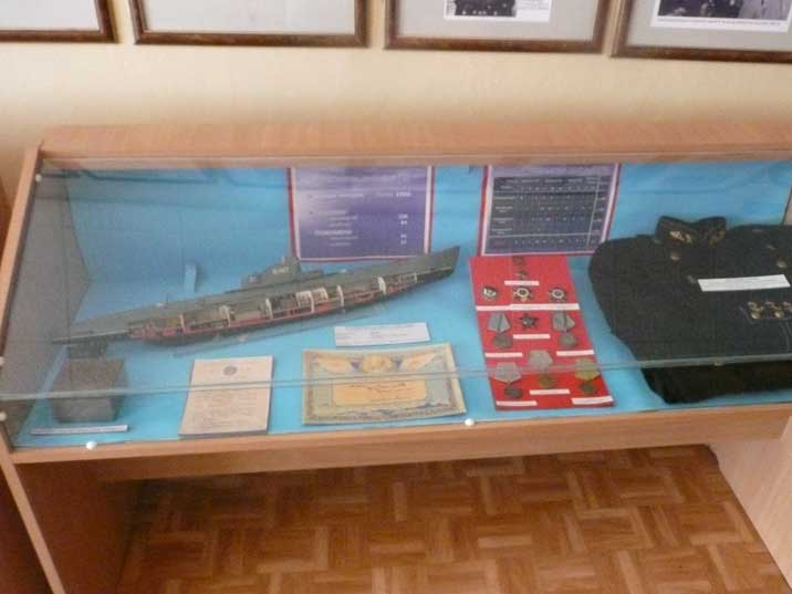 Model of a Whiskey class submarine and officers uniform