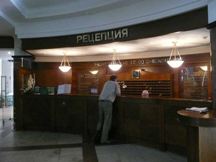 The reception of Hotel Kaliningrad decorated with wood and marble