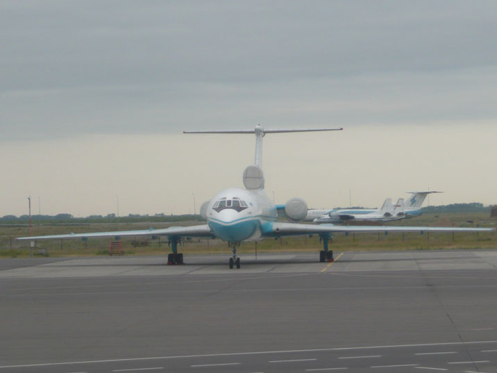 Kaz Air Tupolev Tu-154M on Astana Airport with some other Soviet era aircraft in the background