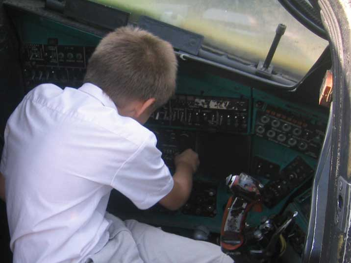 Ukrainian Kid playing in the Mil Mi-24 Helicopter cockpit