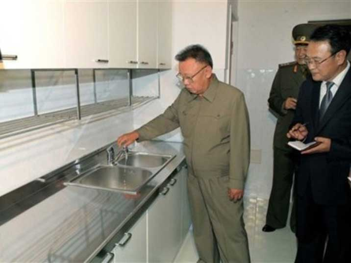 Kim Jong Il testing a water tap in a newly build kitchen