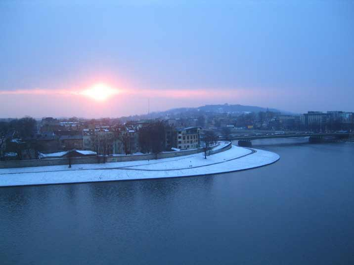 The bend in the Vistula River now seen on a day without any snow from a lookout point at the Wawel Castle