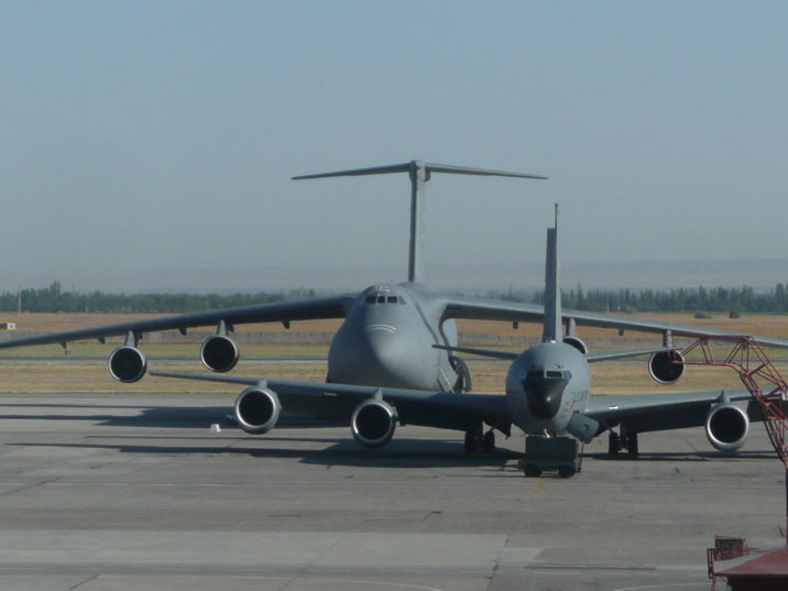 USAF Lockheed C-5 Galaxy parked on the apron of Manas Airport behind a KC-135 Stratotanker