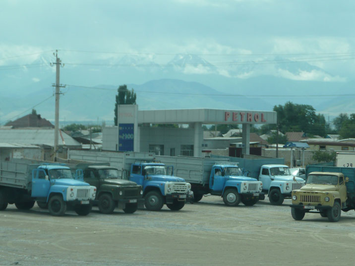 Seven Soviet make trucks on a parking place in the city of Tokmok