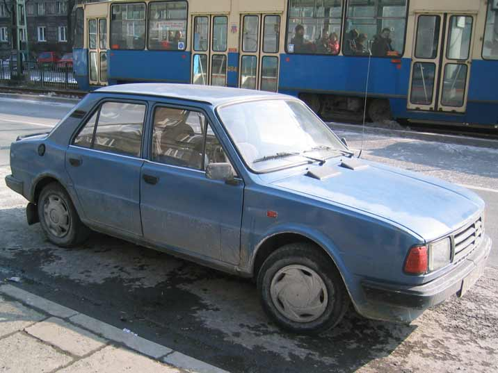 A second generation Skoda 120 seen in Nowa Huta with a Polish Konstal 105Na tram in the background