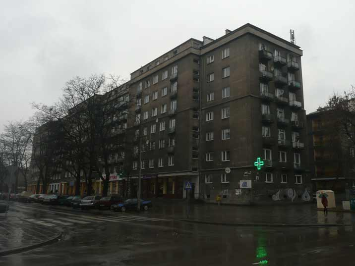 A large housing block with a pharmacy and other stores on Urocze Street close to the centre of Nowa Huta
