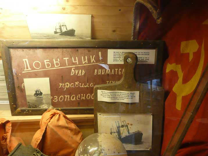 Artefacts that divers recovered from the sunken Soviet OKA 18
