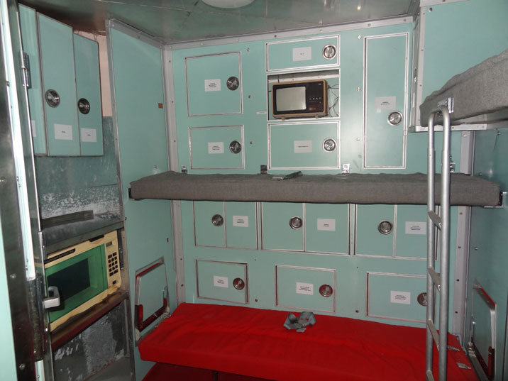 The reserve crew has some basic facilities including a TV, refrigerator and a microwave in the crew compartment