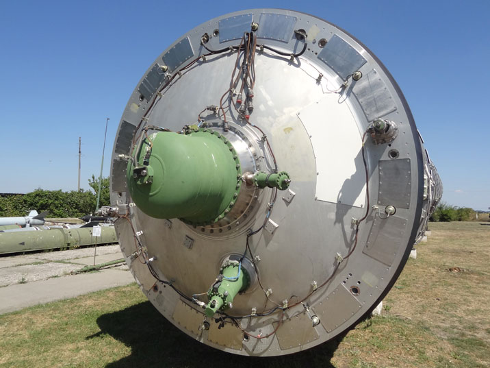 The green cap is an explosive device that boost the missile clear of the silo before rocket engine ignition