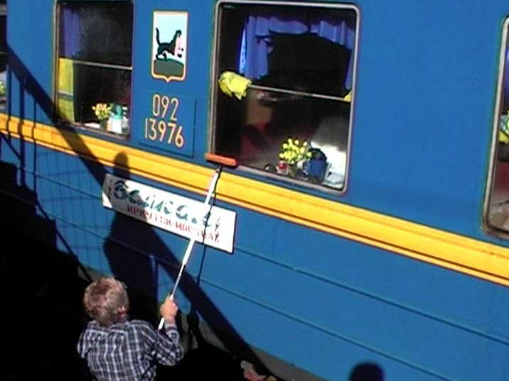 Cleaning the passenger windows of a Russian Trans Siberian train