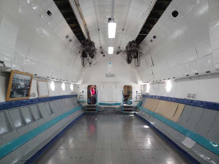 Entrance to the crew area and cockpit of the An-22, also two cranes for handling the cargo on the ceiling