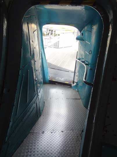 The main crew door into the An-22 located above the centre landing gear close to the ground
