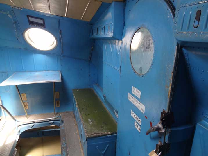 Door to the cockpit in the upper part of the An-22 that is reached by starts from the lower deck