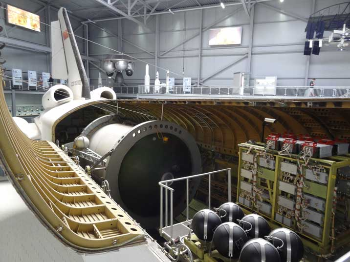 There is more space in the cargo bay of the Buran compared to the Space Shuttle because it does not require its own engine for launch