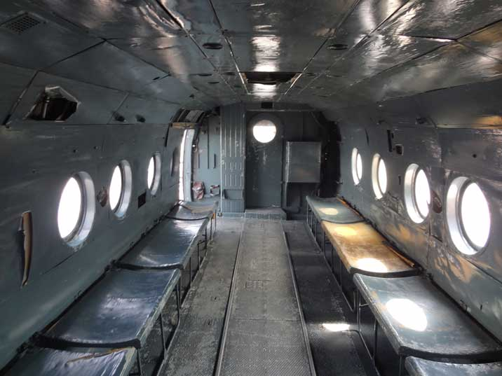The passenger compartment of the Mi-8 that can transport 24 troops in addition to its armament anti tank rockets