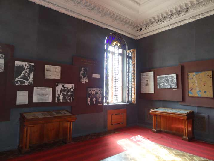 Decorated window and various photos in the second exposition hall of the Stalin museum
