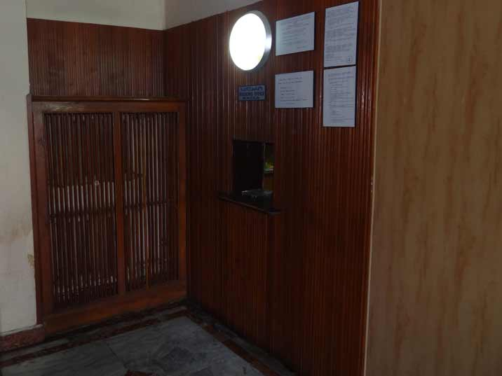 The ticket booth of the Stalin Museum is a small window tucked away in a corner as seen im many Soviet museums