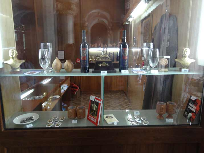 Various souvenirs like Wine, pottery and buttons with Stalin's picture are on sale in the small museum shop