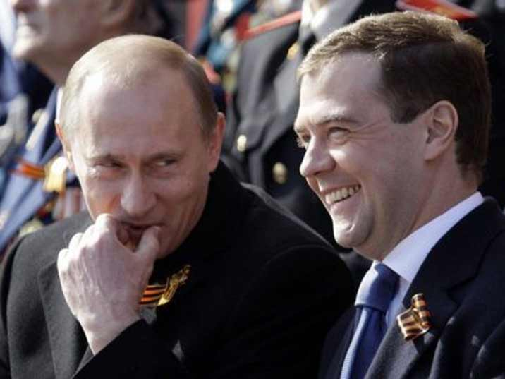 Putin has some naught thoughts while looking at his buddy Medvedev