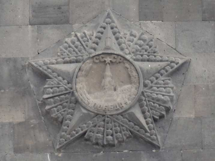 The famous Soviet Order of Victory on the pedestal of the Mother Armenia Statue carved out of stone