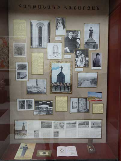 Display box with photos and documentation about the history of the Mother Armenia monument in Victory Park