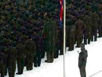 A giant was spotted on one of the official North Korean photos of the Kim Jong Il funeral, was this am other fake or a real man of 2.40m?