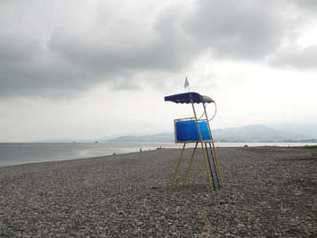 Deserted lifeguard lookout post on a rainy day in the Sea Side resort Batumi with the Black Sea in the background