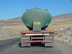 Iranian trucks transporting oil are a common sight in the mountains Sisian province in Southern Armenia