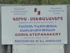 Sign on the Gori to Stepanakert highway proclaiming that the highway was build with financial help of the Armenian Diaspora