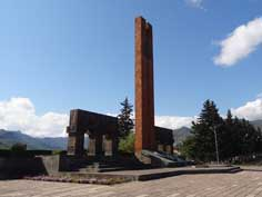 The Soviet World War II memorial in Stepanakert with the mountains of Nagorno-Karabakh in the background