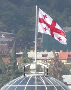 The Georgian flag that was reintroduced after 500 years in 2004 flying on the Presidential Palace in Tbilisi