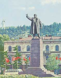 Lenin statue on Lenin Square of Tbilisi with the city hall and the Armenian Motherland statue in the background
