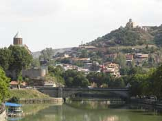 The Metekhi Bridge with the Tbilisi Metekhi Church, Thabori Monastery and the Old Town in the background