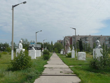 Statue gallery with a collection of removed Soviet monuments on an open patch of land in the city of Aksu