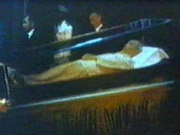 The embalmed body of Ho Chi Minh displayed in a glass casket