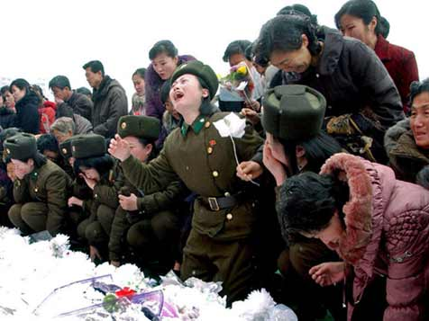 Female soldiers crying over the death of Kim Jong Il in Pyongyang, analysts doubt if the emotions are sincere