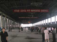 The platform of the Pyongyang train station with part slogans