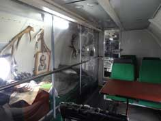 Living and working compartment of the GDR government aircraft with a desk, bed and working area