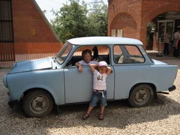 Kids playing in an Trabant at the entrance of Szoborpark