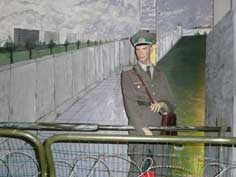 An East German Border Guard on post near the Wall in East Berlin